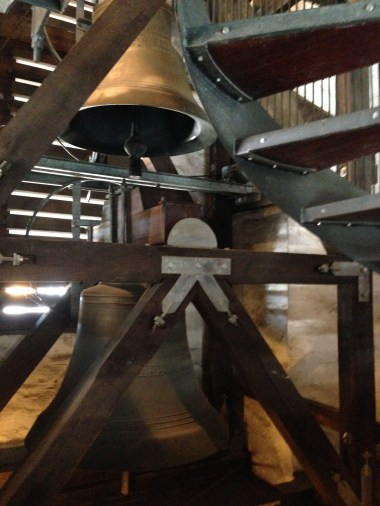 While passing the bells on the tower's staircase, the clock struck 12:30 and the bells rang loudly causing us to nearly fall down the stairs.