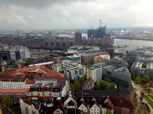 View over Hamburg from the top of St. Michaeliskirche. In the distance, you can see HafenCity, one of the largest construction sites in Europe. They are also constructing a new opera house.