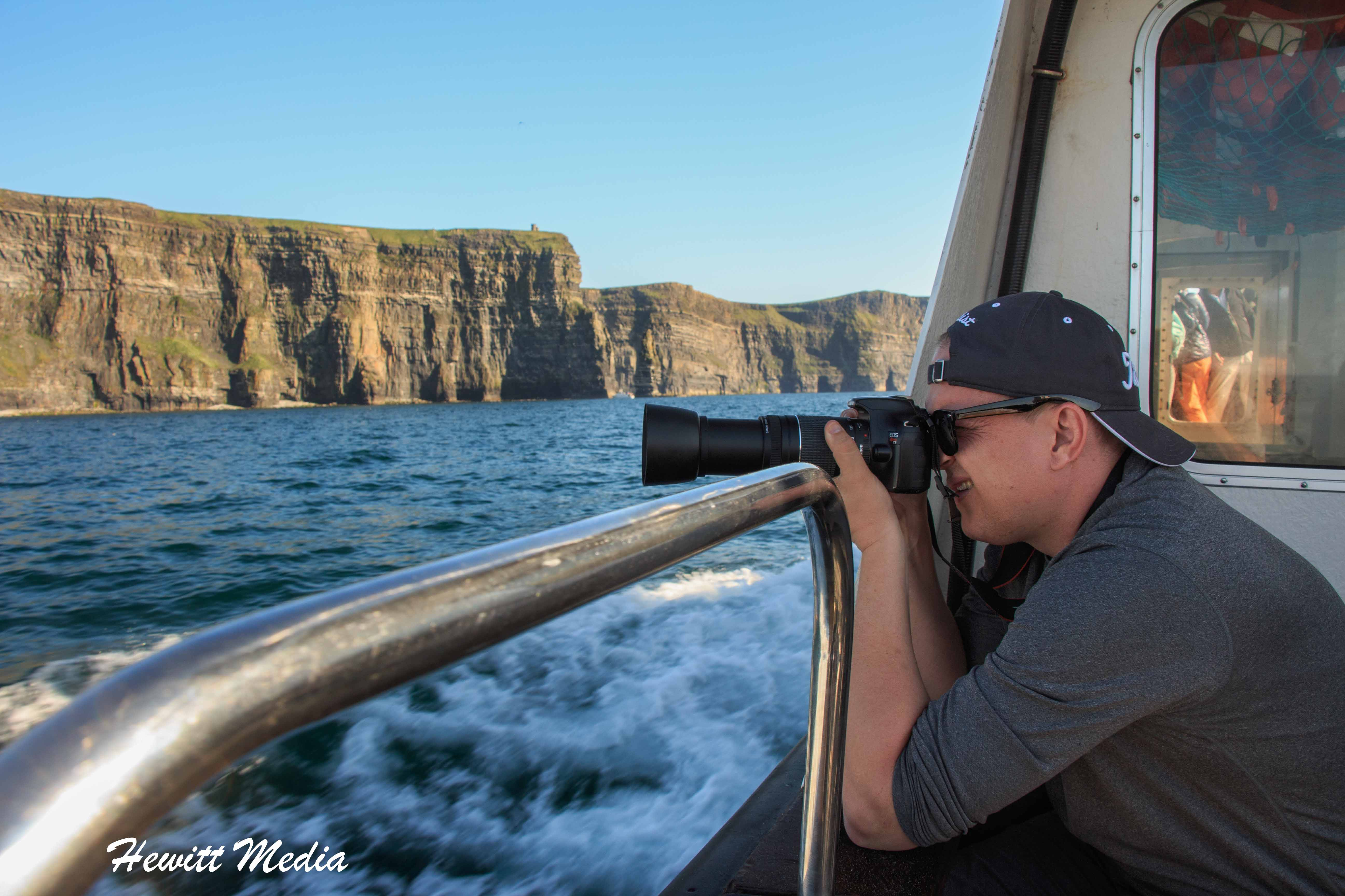 Photographing the birds nesting in the cliffs at the Cliffs of Moher