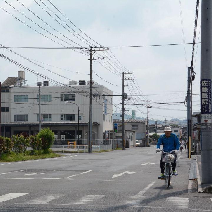japanese man riding bike okayama