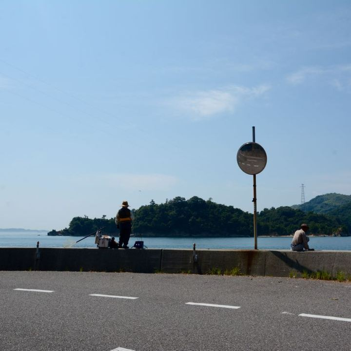 shimanami kaido cycling seto inland sea oshima fisher