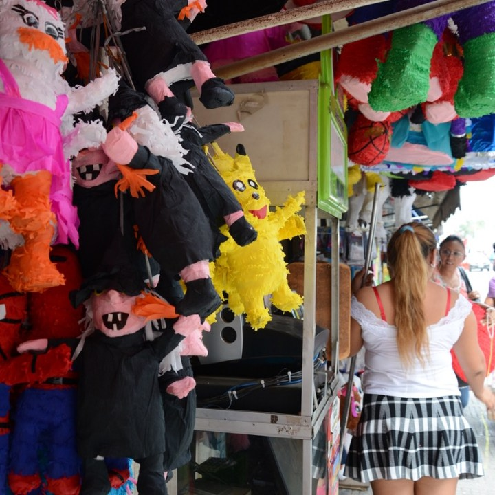 Travel with children kids mexico merida pinata shop
