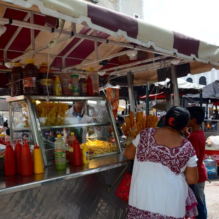 Travel with children kids mexico merida sunday market plaza grande food stall