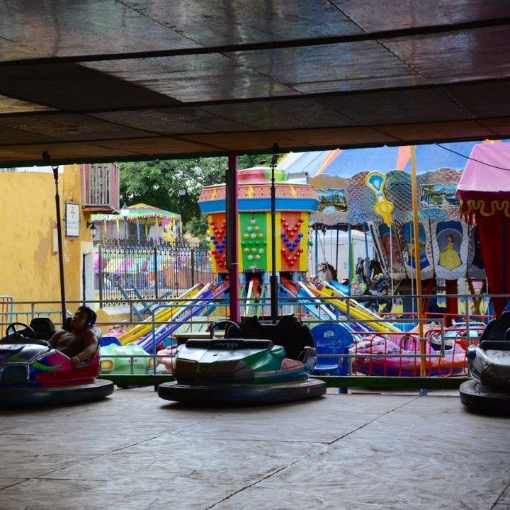 Travel with children kids mexico merida izamal festival ride