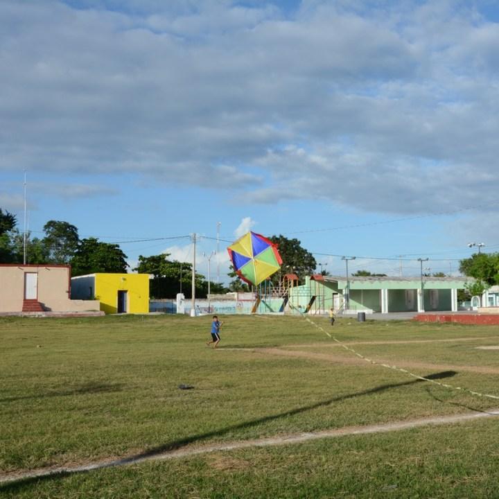 Travel with children kids mexico merida izamal cacalchen kite flying