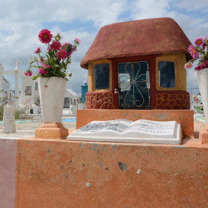 Travel with children kids mexico merida cemetery hanal pixan