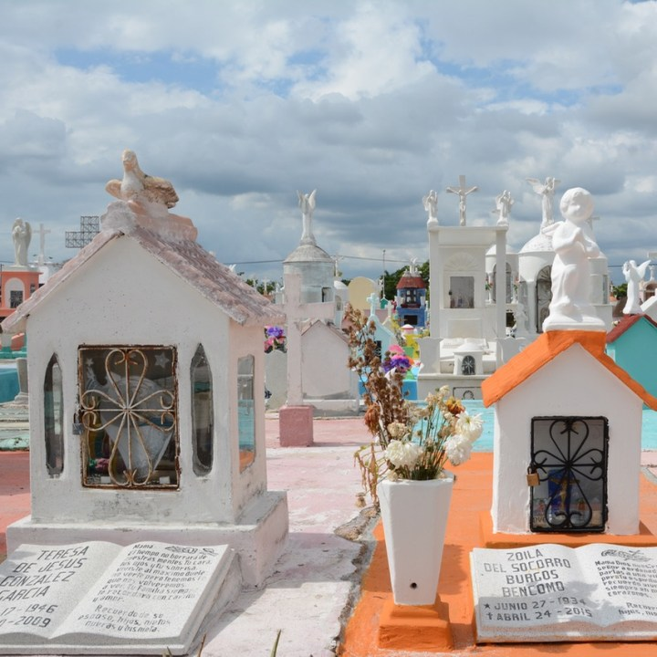 Travel with children kids mexico merida cemetery graves