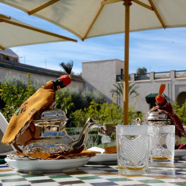 Travel with children kids Marrakesh morocco medina secret garden Tea break