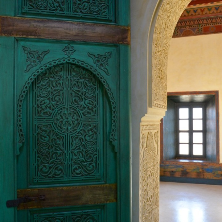 Travel with children kids Marrakesh morocco medina secret garden tower door