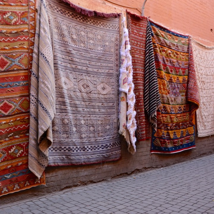 Travel with children kids Marrakesh morocco medina secret garden carpets