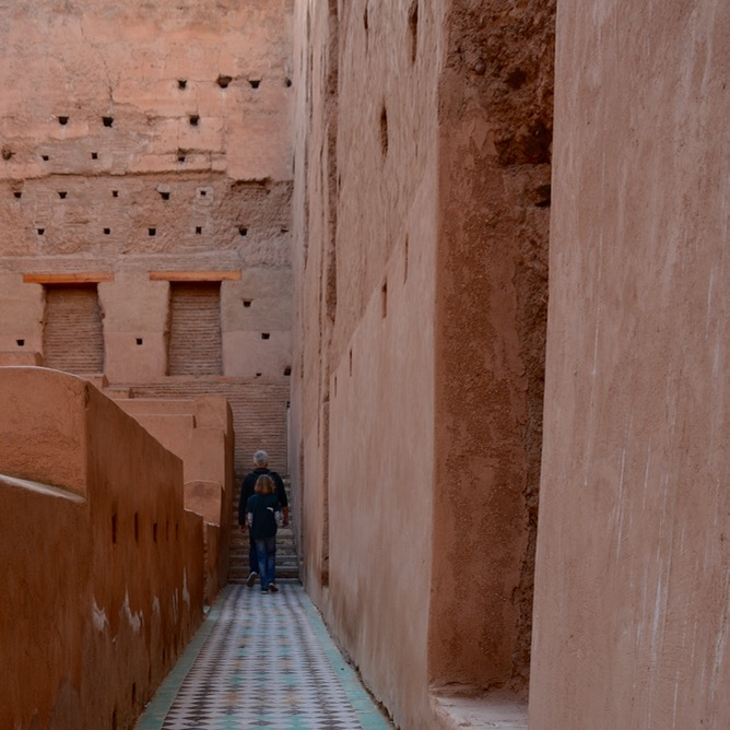 Travel with children kids Marrakech morocco badia palace walkway