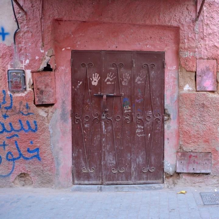 Travel with children kids Marrakesh morocco medina souk doorway