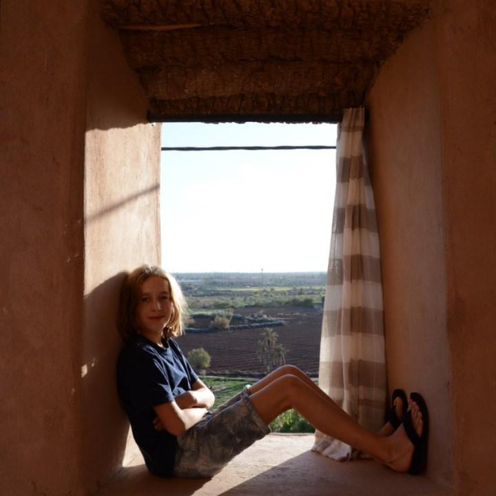 travel with kids children morocco marrakech hotel caravanserai window