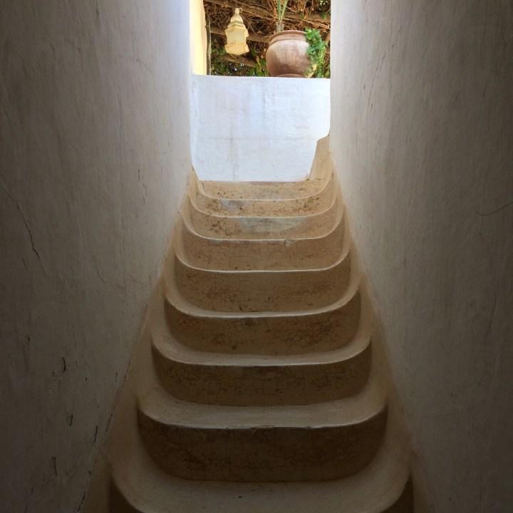 travel with kids children morocco marrakech hotel caravanserai stairs