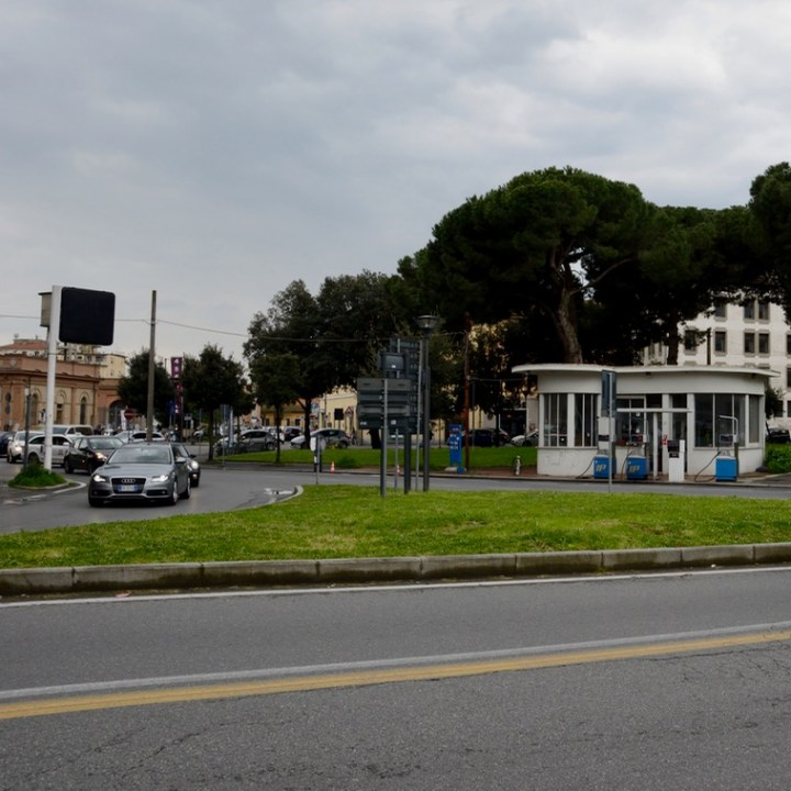 Travel with kids children pisa italy petrol station architecture