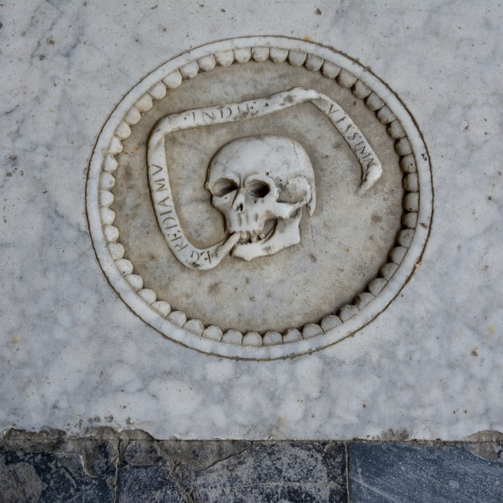 travel with kids children pisa italy miracle square cemetery skull tomb stone