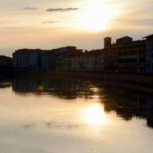 travel with kids children pisa italy river arno sunset