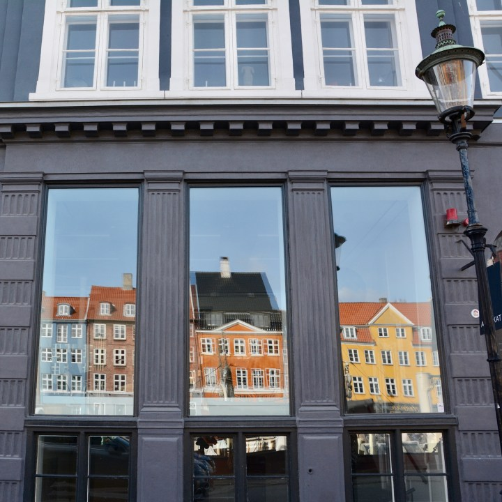 travel with kids children Copenhagen Denmark nyhavn canal reflection