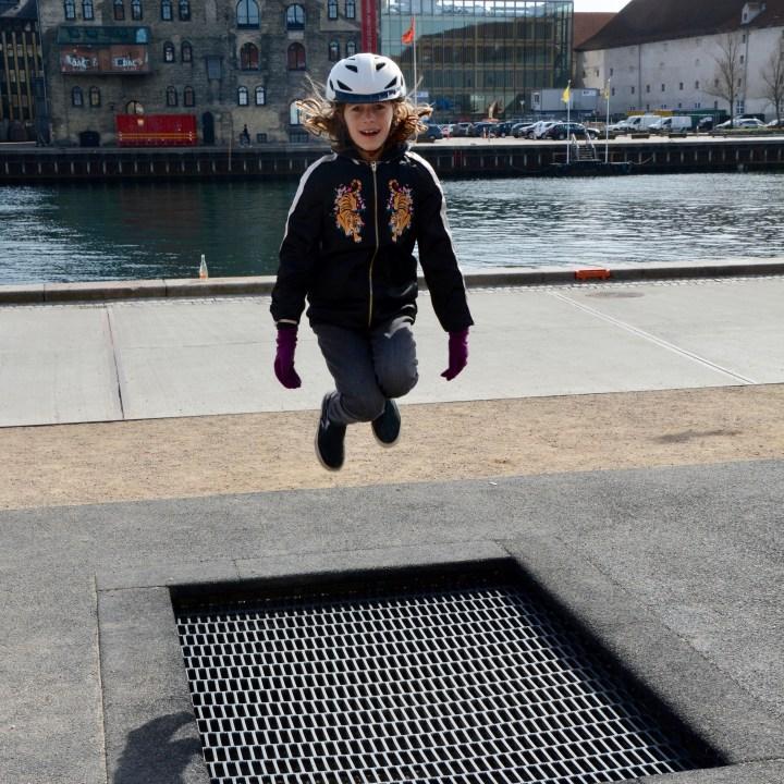 travel with kids children Copenhagen Denmark nyhavn canal trampoline playground