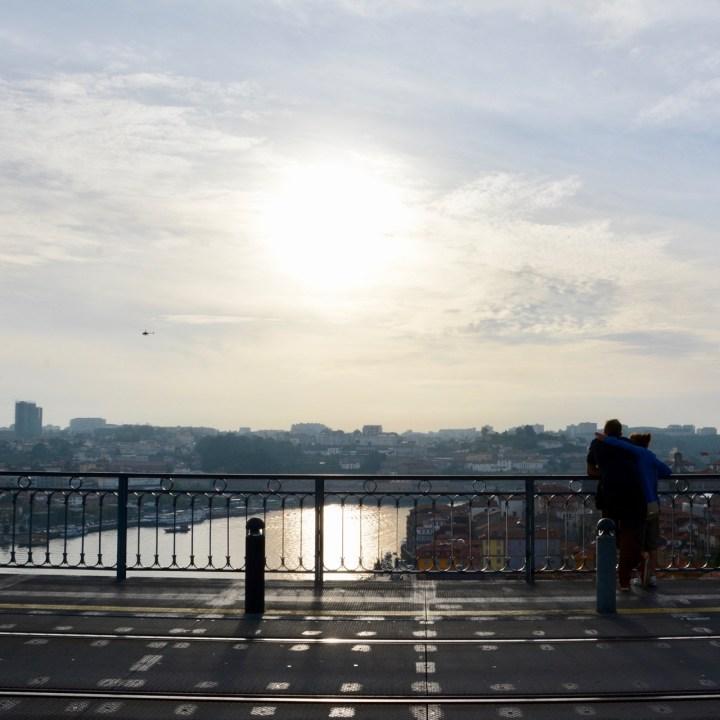 travel with kids children porto portugal bridge view