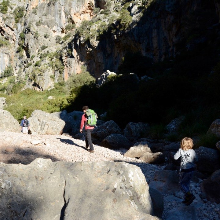travel with kids children soller mallorca spain hiking torrent de pareis stream bed
