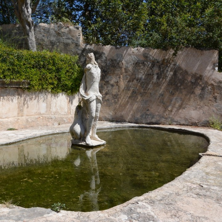 travel with kids children mallorca spain raixa estate pond statue