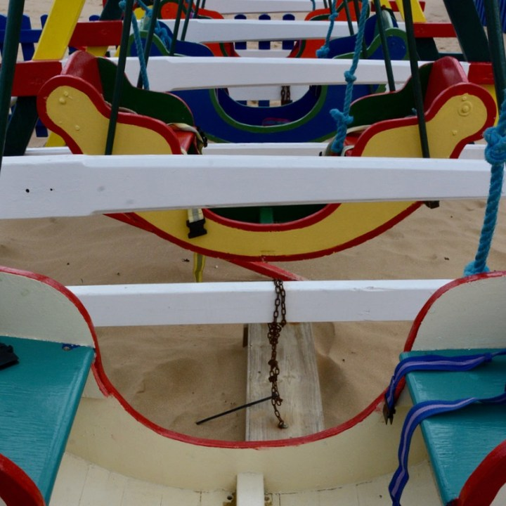 coloured swing boats