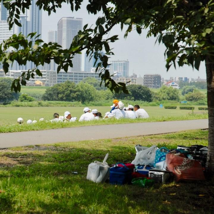 cycling the tame river tokyo japan with kids baseball player
