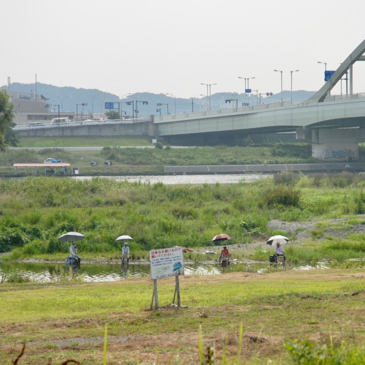 cycling the tame river tokyo japan with kids fisher men