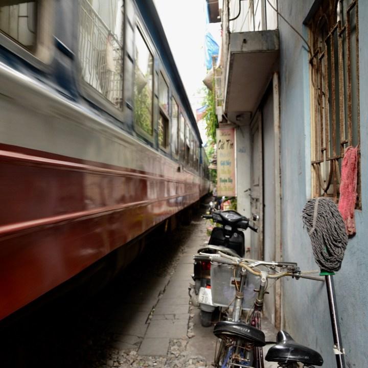 travel with kids vietnam hanoi train passing