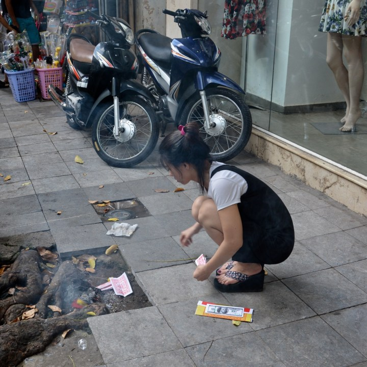 travel with kids vietnam hoi an burning money