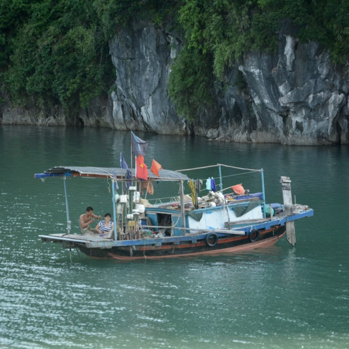 vietnam with kids ha long bay fisher boat