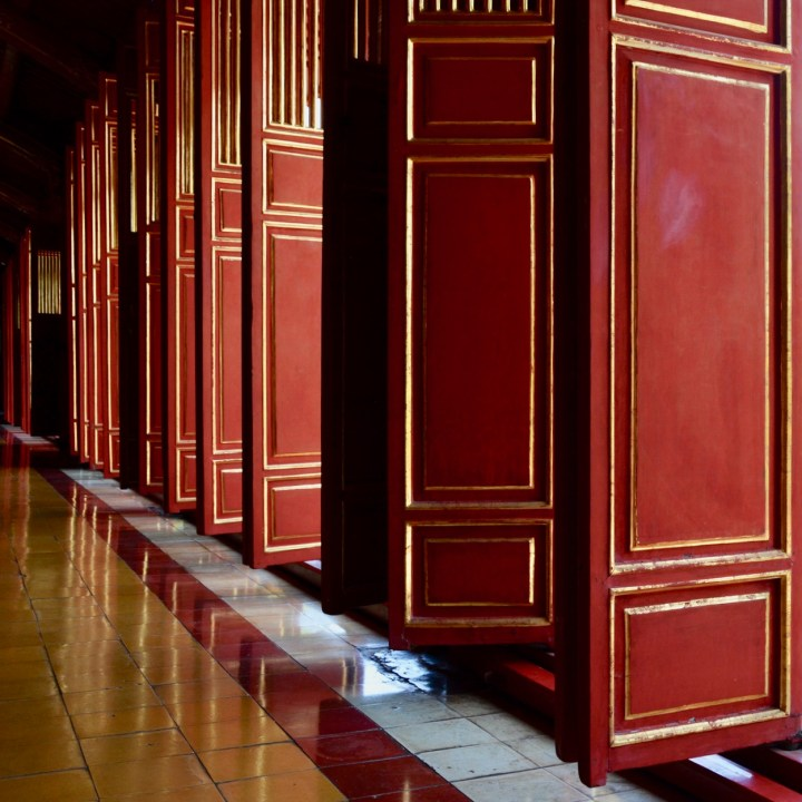 vietnam travel with kids hue citadel red doors