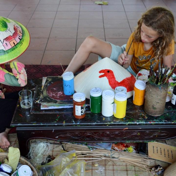 vietnam travel with kids hue citadel non la hat painting