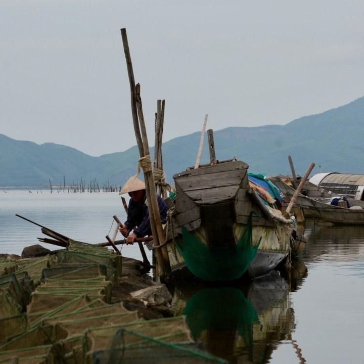 vietnam travel with kids vedana lagoon fisher man