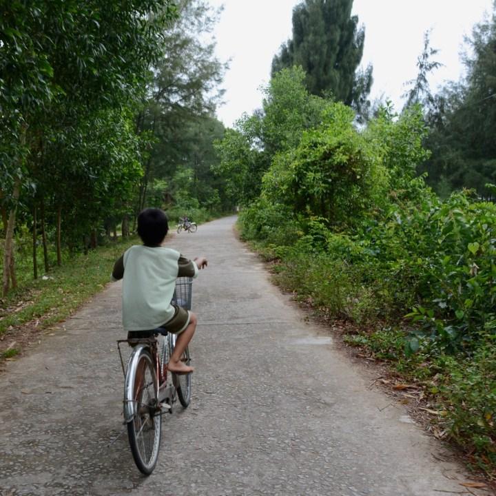 vietnam travel with kids da bac village local kids