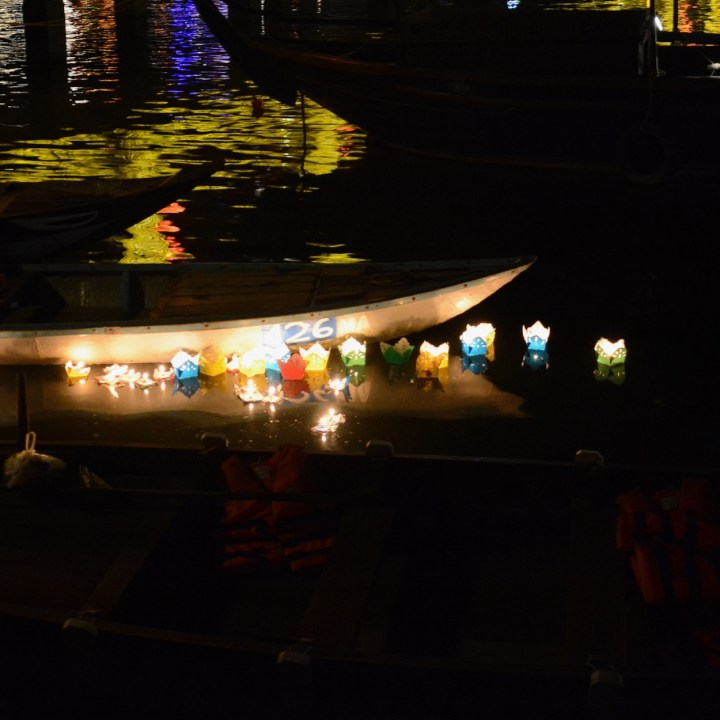 hoi an by night with kids swimming lights