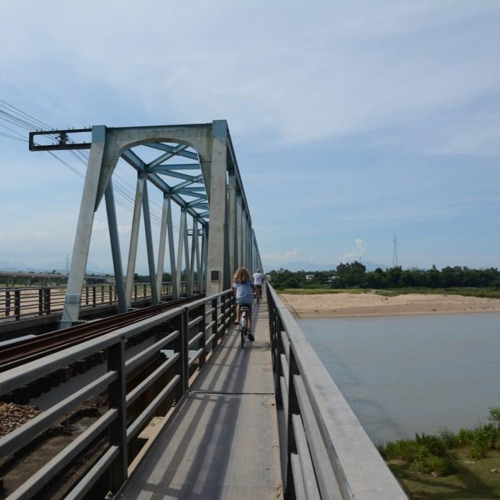 vietnam travel with kids hoi an rural bike ride train bridge