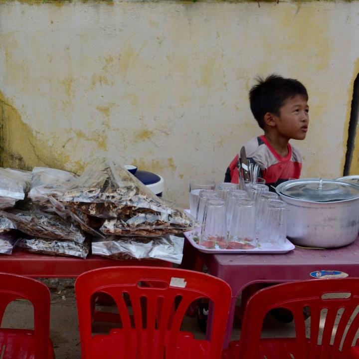 travel with kids vietnam tam than art village boy