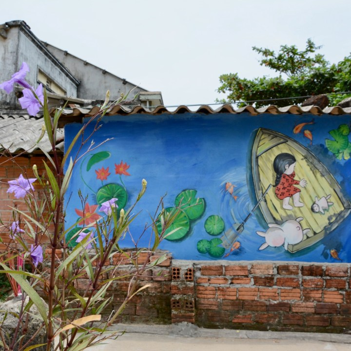travel with kids vietnam tam than art village girl