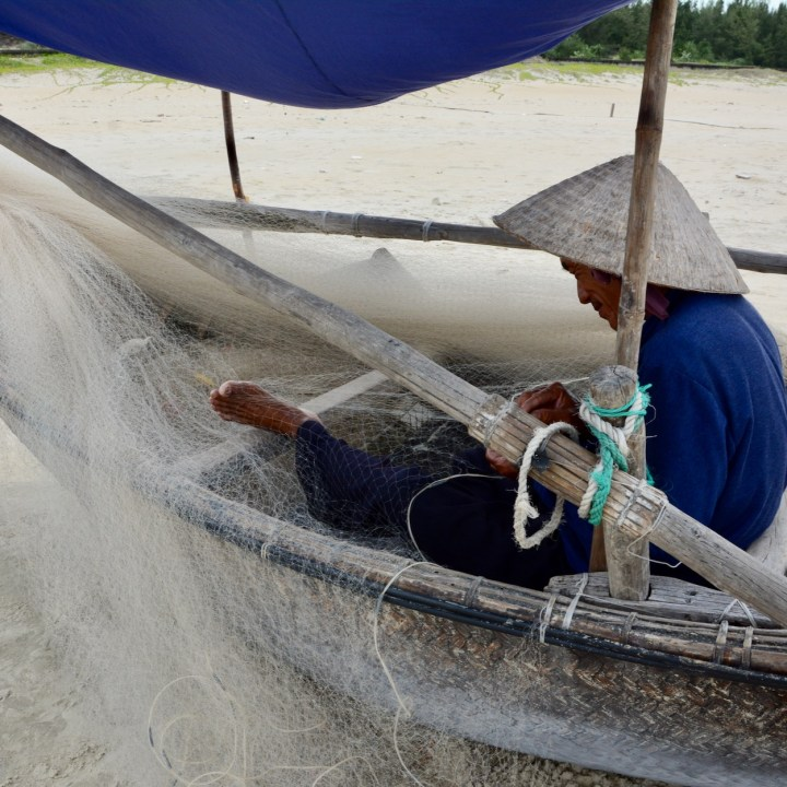 travel with kids vietnam tam than beach fisher man