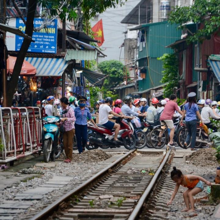hanoi with kids train crossing motorbike jam
