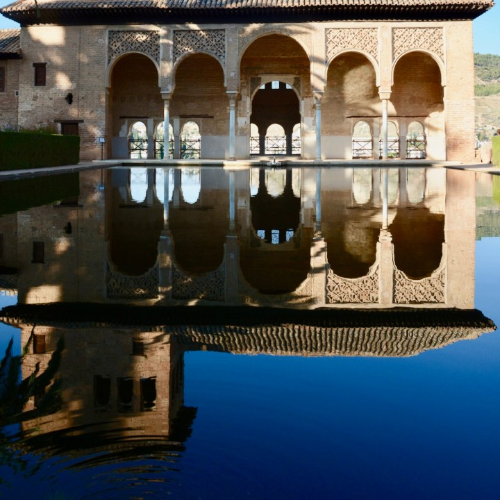 alhambra with kids nasrid palace pond reflections
