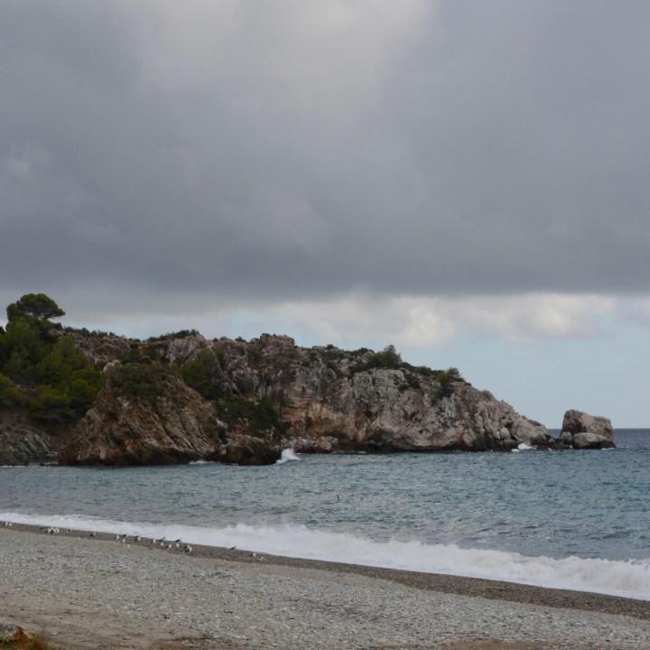 deserted beach with kids costa tropical rocky beach