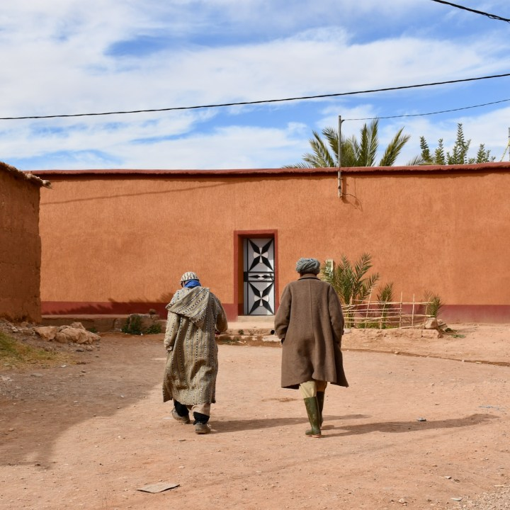 Ait Benhaddou with kids Morocco local men