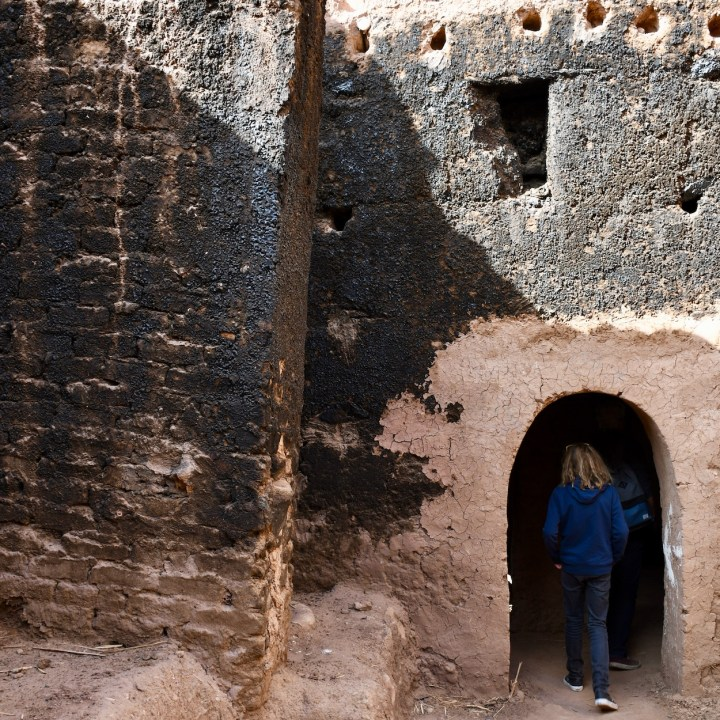 Ait Benhaddou with kids Morocco charred walls