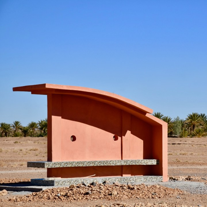 Morocco with kids drive M'Hamaid bus shelter