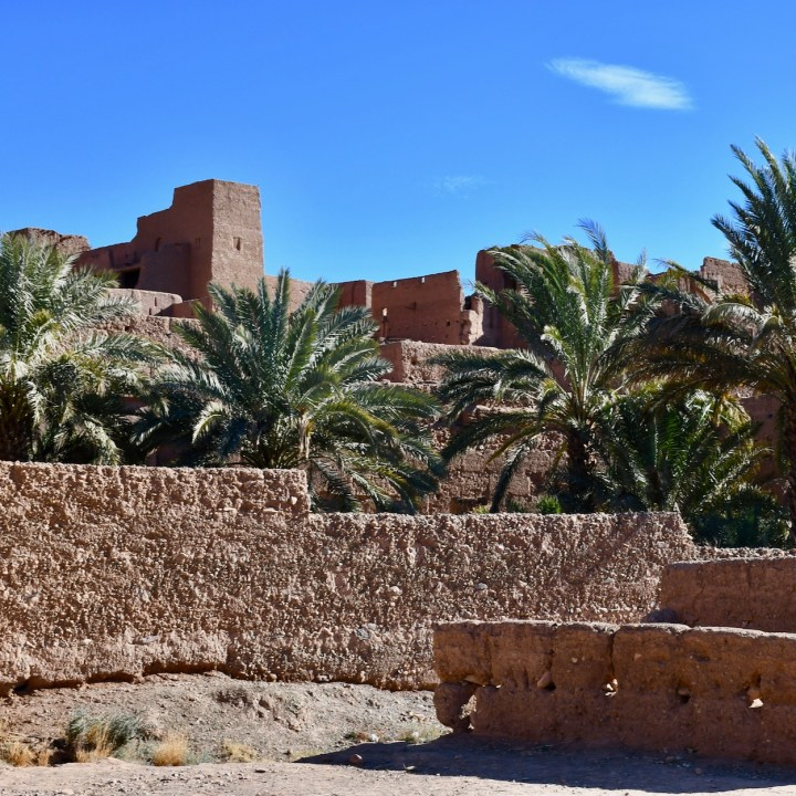 kasbah caids with kids Morocco mud brick houses