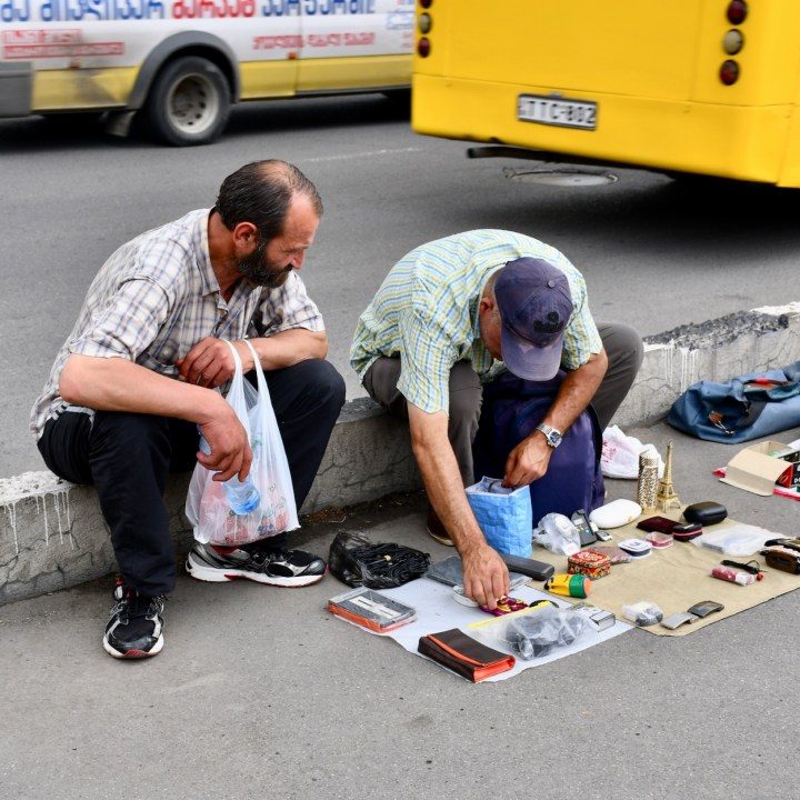 Tbilisi with kids Dry Bridge Market sorting goods
