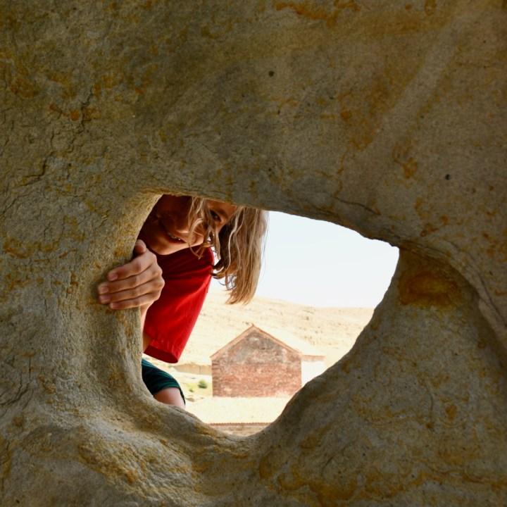 Uplistsikhe cave town with kids peek a boo